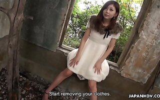 Profligate slim Japanese spread out stripteases everywhere left alone house and flashes hairy pussy