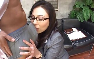 Interracial fucking in the office with a Japanese secretary
